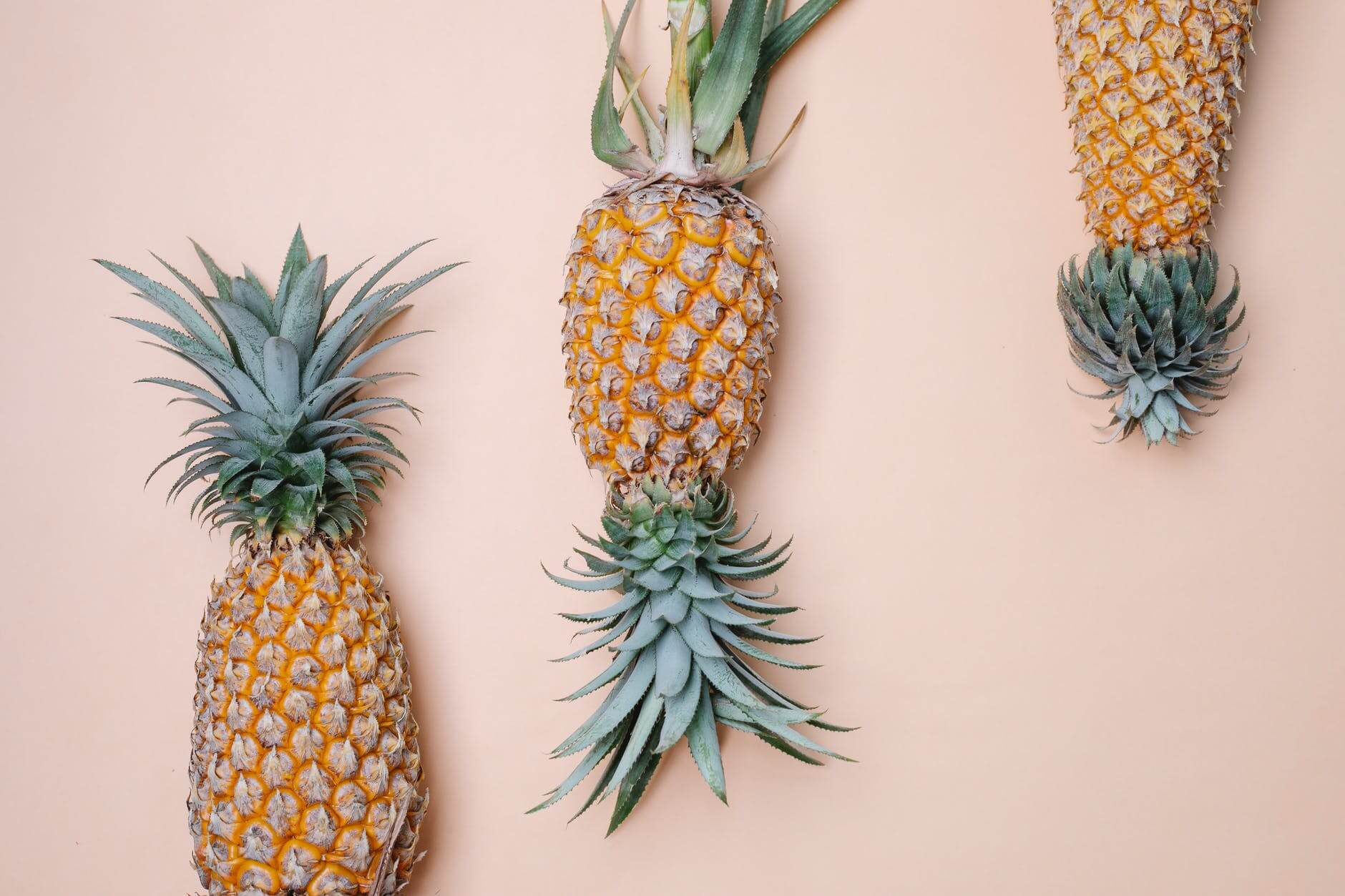 big pineapples on beige surface